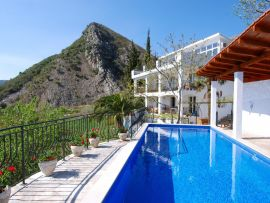 Villa, pool and hillside view
