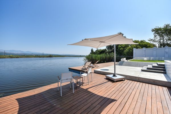 Sunbathing platform and boat mooring
