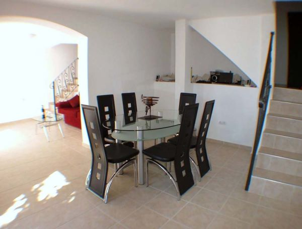 Dining room showing separate staircases to the apartments